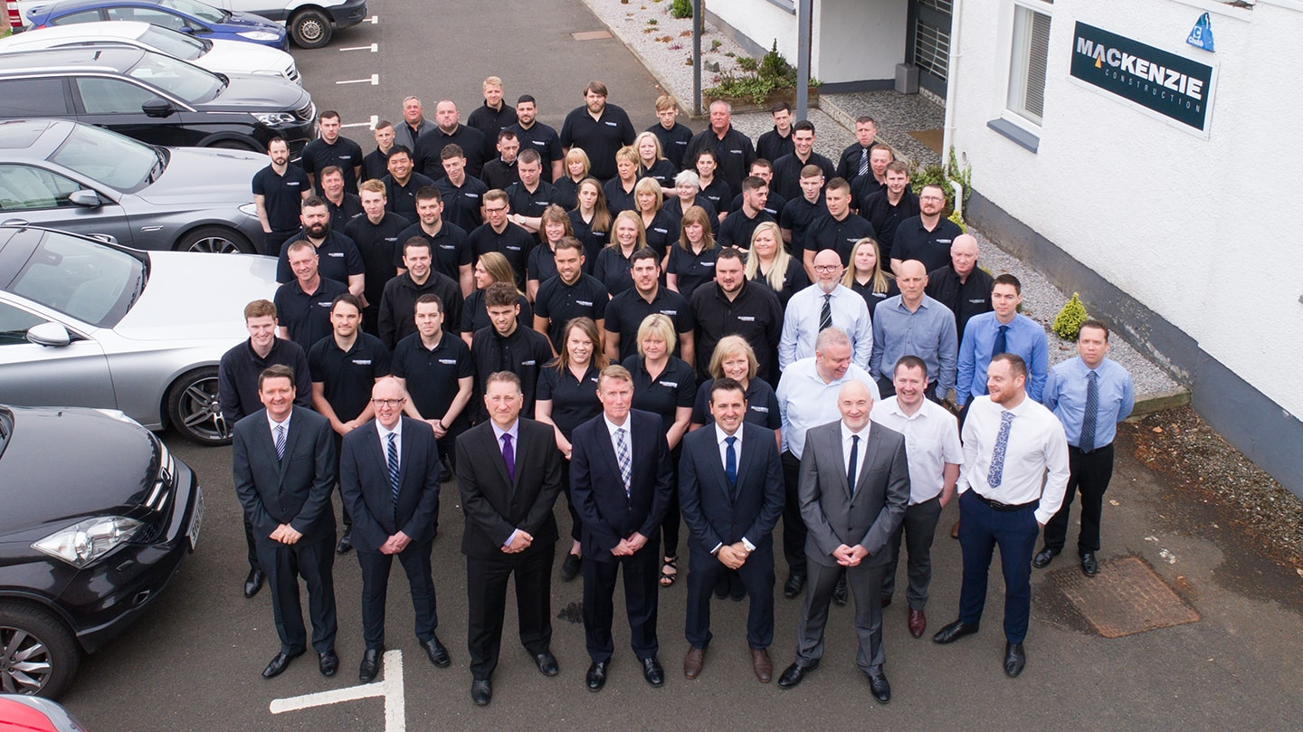 Our team - All Mackenzie Construction Staff outside their Glasgow offices
